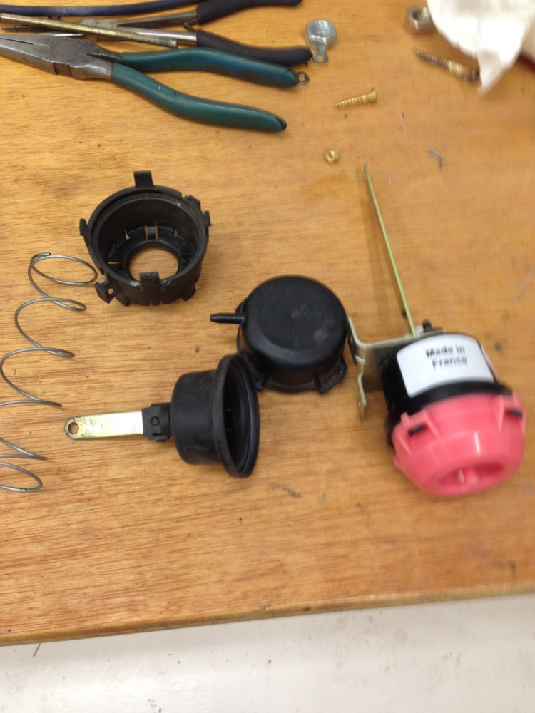 The pink actuator is for the defrost valves.  The black one is for the recirc assembly.