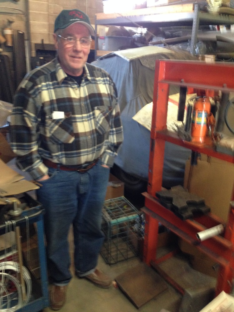 John poses with his hydraulic press.
