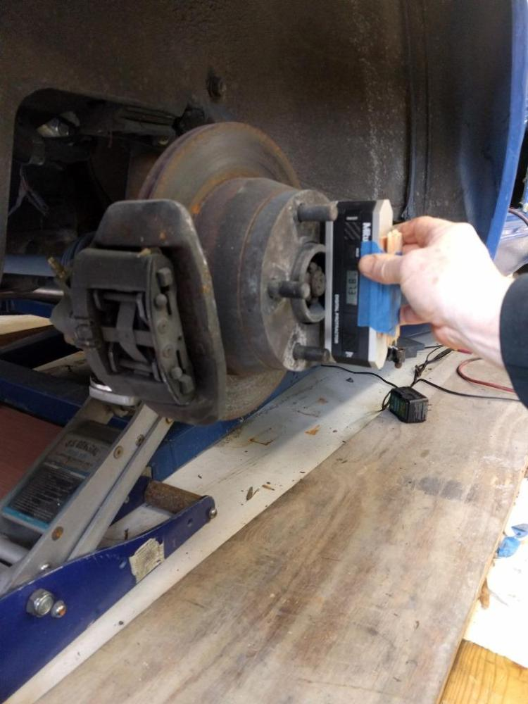 Camber at the hub being measured.