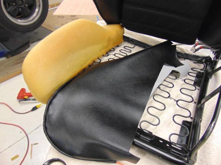 Seat frame, bolster foam, and new bolster vinyl piece.