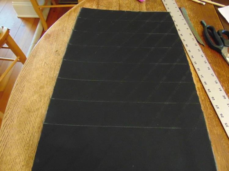 Here the fabric has been glued to the foam and the reference lines for the stitching later. Don't add the lines until after you have glued the cloth, as it will move a little on you up to that point. The lines are done in chalk, which can be wiped away later .