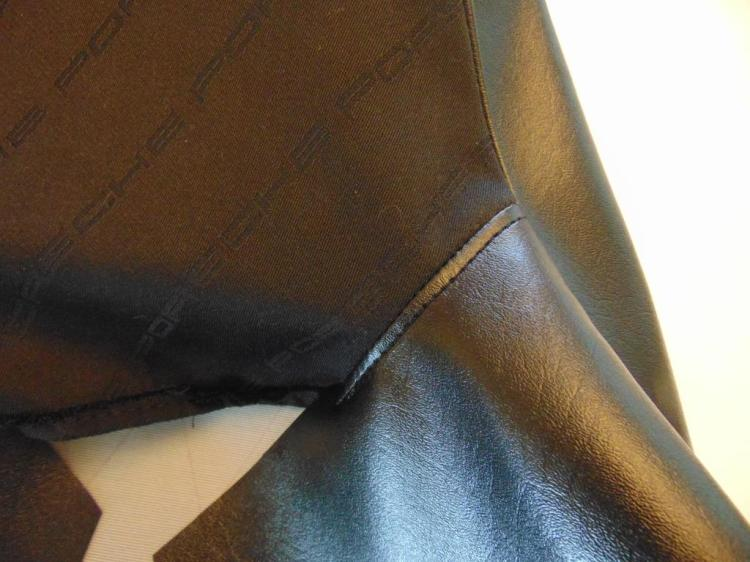 Closeup of the seam between the headrest fabric and the bolster piece. You want to sew this first so that the outer of the end of the seam can be captured within the circumferential seam for the larger piece, thus giving an attractive finished appearance.